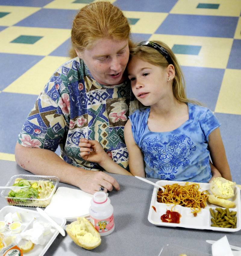 Vicki McMahan and her daughter, Cheyennee, 8, eat a spaghetti dinner Wednesday at Lincoln Middle School on Stevens Avenue in Portland as part of a summer nutrition program sponsored by the Portland Public Schools Food Service and the Wayside Community Food Program.