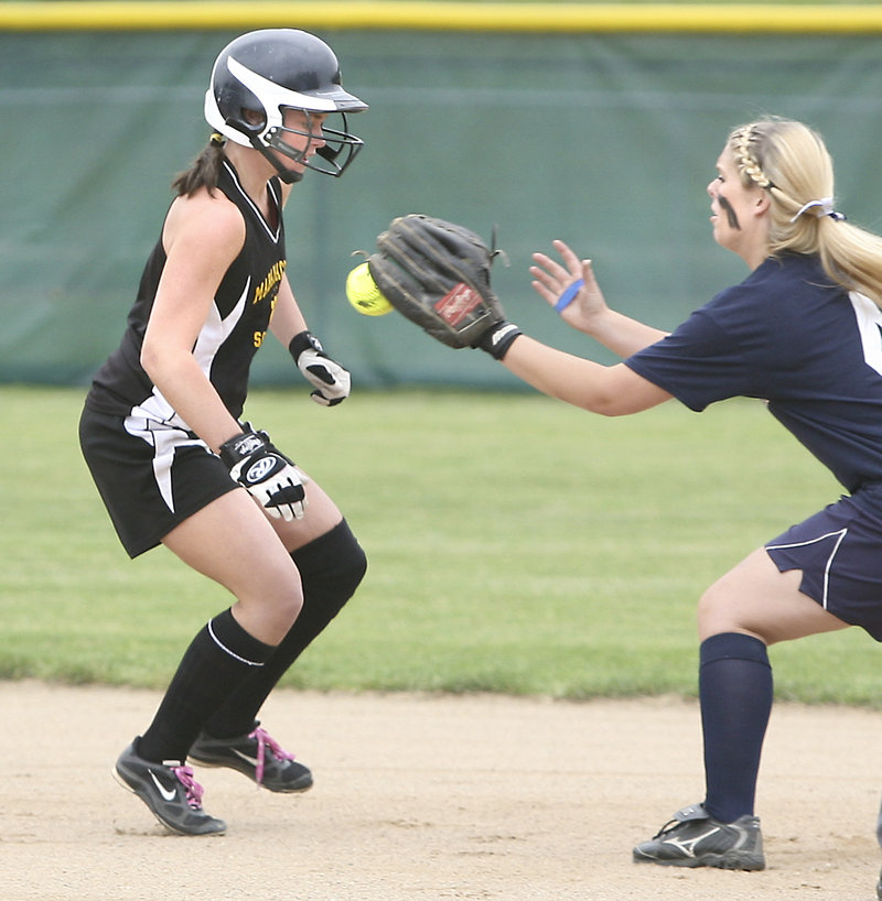 Heidi Shaw of Maranacook is tagged out at second base by Ariel McConkey of Fryeburg Academy after getting caught in a rundown Wednesday, Fryeburg won, 4-3.