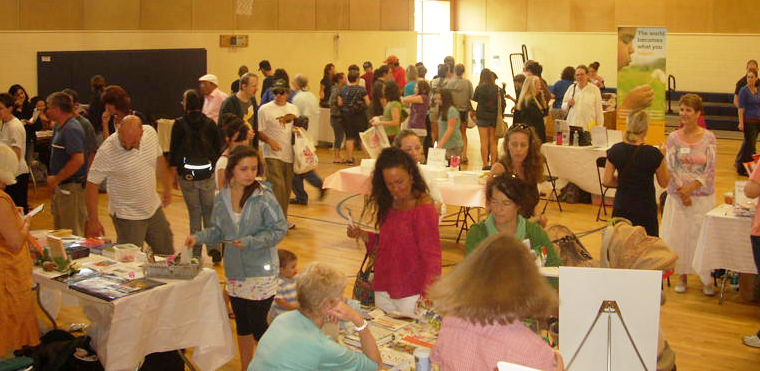 Attendees chat with exhibitors and enjoy free food samples at the 2009 Vegetarian and Vegan Food Fesitval.