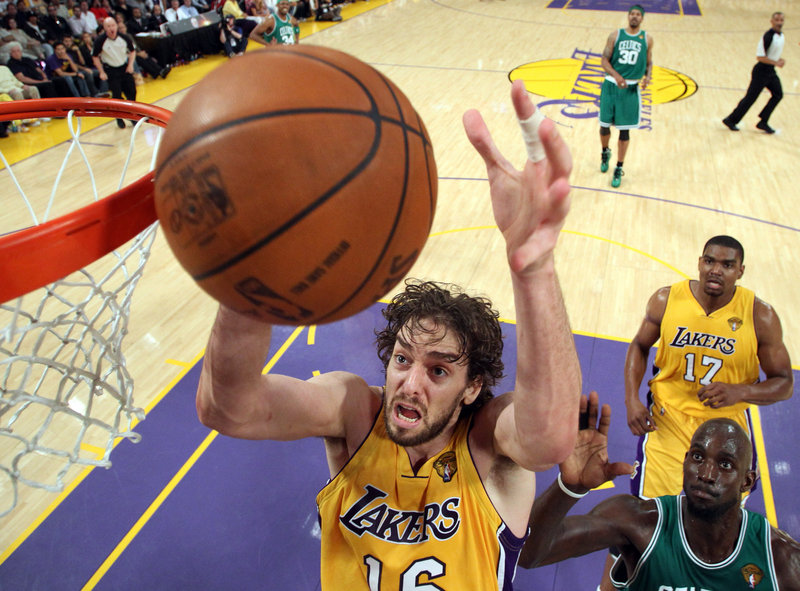 Pau Gasol of the Los Angeles Lakers makes room inside Thursday night to pull down a rebound during the first half of the Game 7 showdown against the Boston Celtics.