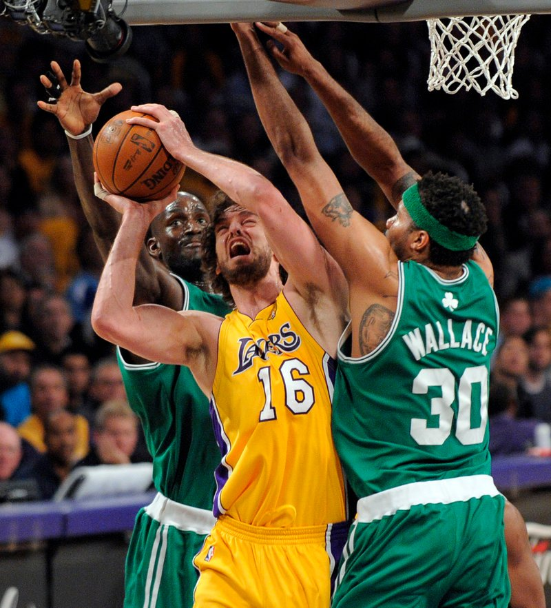 Pau Gasol of the Los Angeles Lakers has trouble finding room Thursday night while guarded by Rasheed Wallace, right, and Kevin Garnett of the Boston Celtics. The Lakers won.
