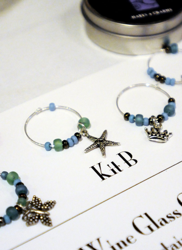 Wine charms are one of six Art Night Out kits designed by entrepreneur Catherine Bickford. Bickford sought advice on marketing the kits from those attending a Women Standing Together lunch at the Portland Harbor Hotel. Group members help each other overcome business challenges.