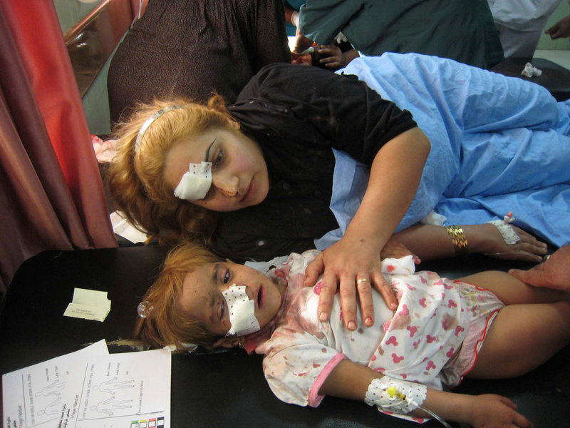 A wounded Iraqi woman and her daughter are treated at a hospital after a car bombing in Tuz Khormato, in northern Iraq, Friday. Separate attacks killed 16 across the country.