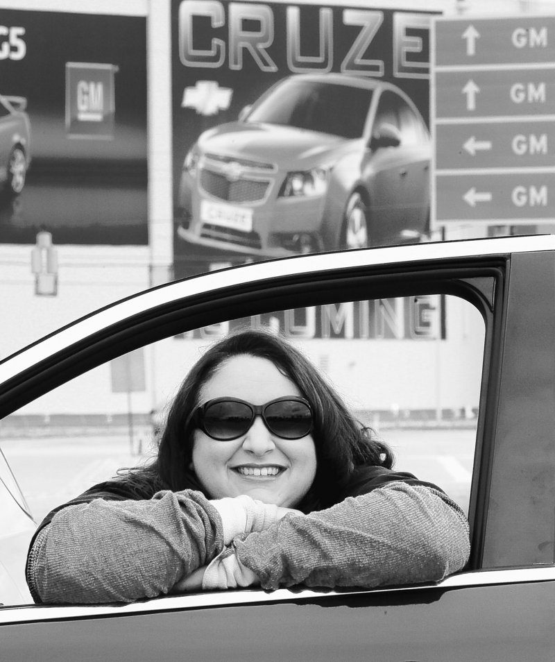 United Auto Workers member Bobbi Marsh looks out the window of her new Chevy Equinox outside the GM plant in Lordstown, Ohio on Thursday. Laid off from several teaching jobs, Marsh is glad to have found employment at the plant.
