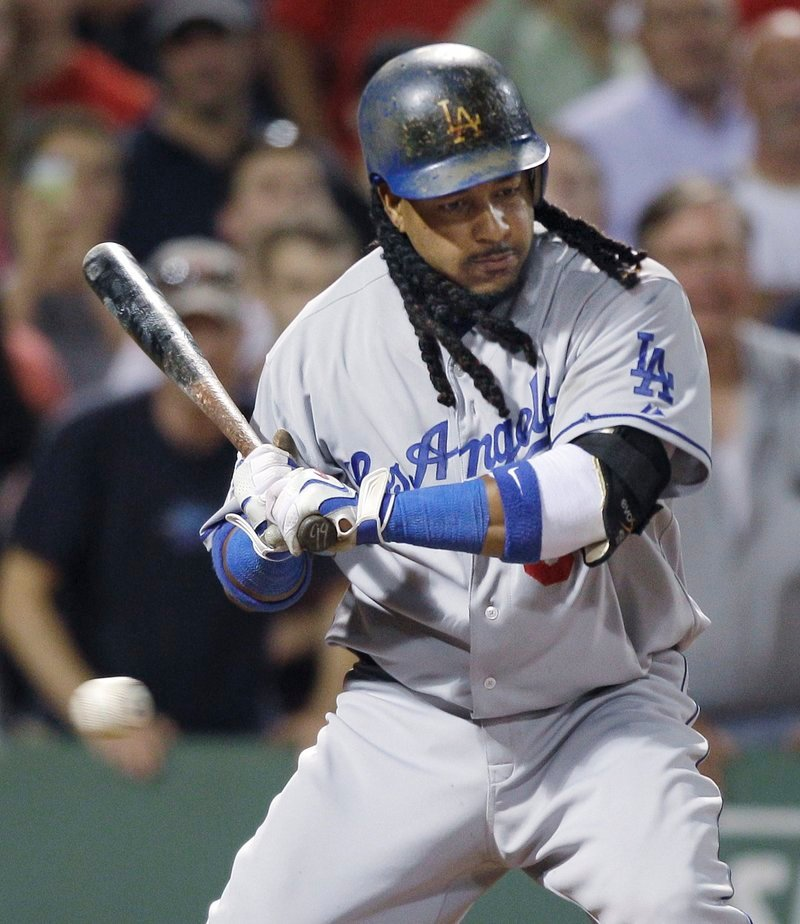 Manny Ramirez watches a third strike zip by in the ninth inning Friday night to end the game with two runners on. Boston beat the Los Angeles Dodgers, 10-6.