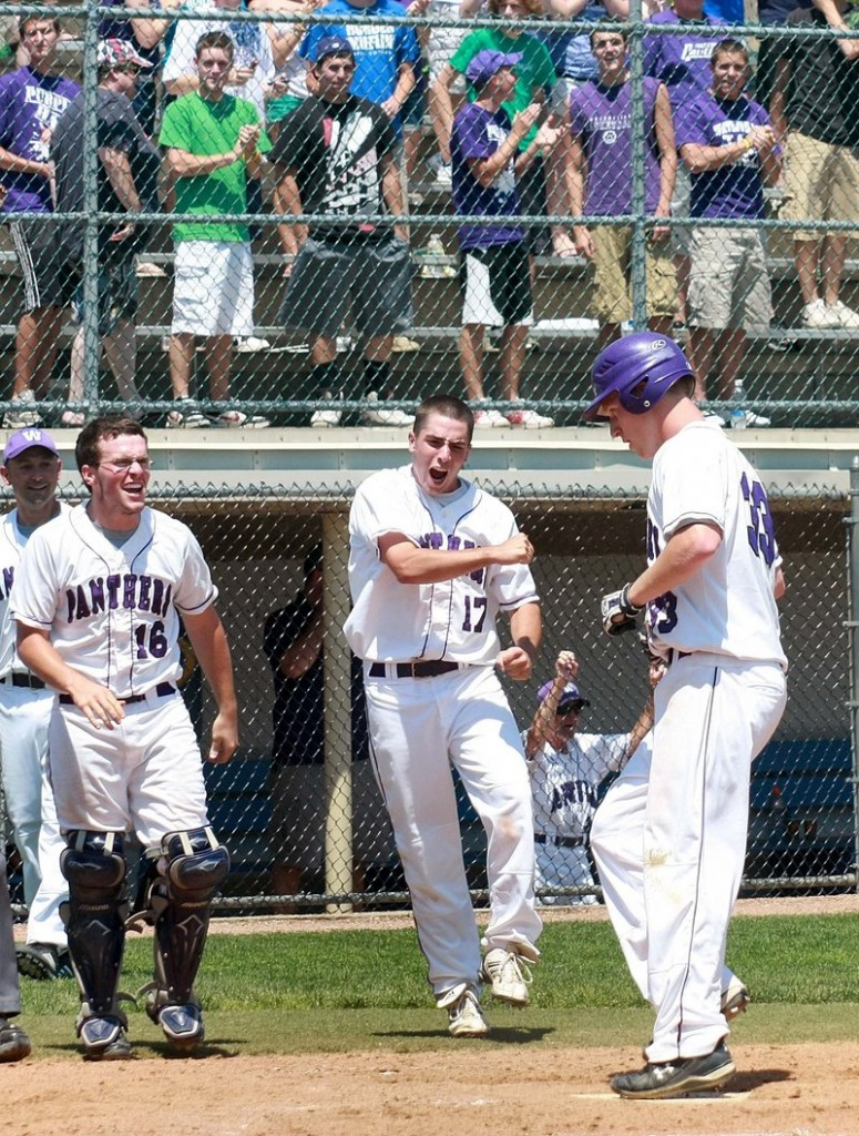 Tim Locke of Waterville is welcomed by catcher Brendan Scully and Kyle Bishop after hitting a solo home run in the fifth inning Saturday. The Purple Panthers went on to down Cape Elizabeth 9-5 in the Class B state final at Bangor.
