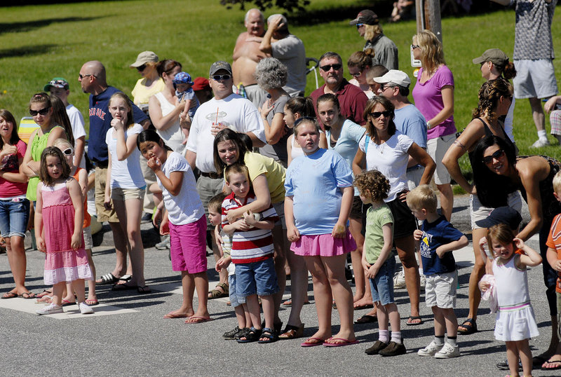 Parade-goers look left to see what's coming next down Route 202. Windham officials say their Summerfest parade is the biggest in the area.