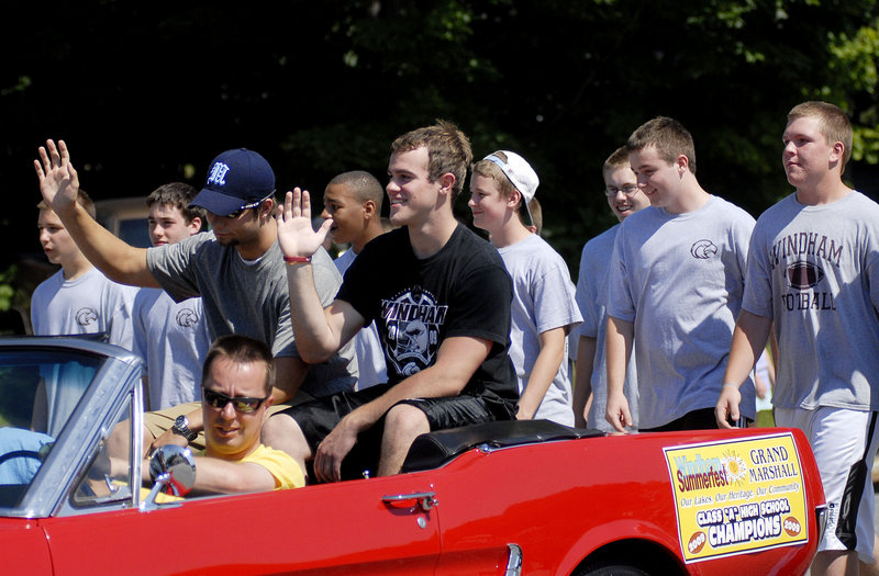 Members of Windham High's 2009 football team – the state champions – march as a collective Grand Marshal of the parade.