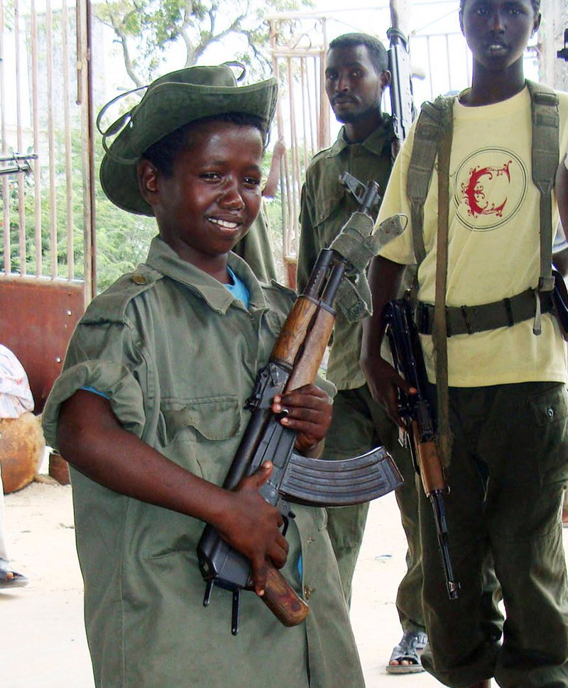 This 2009 photo shows a child soldier of the Somali government on patrol in the streets of southern Mogadishu.