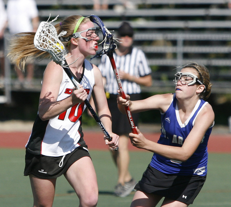 Maggie Smith, left, of Scarborough looks to get around the defense of Maggie Bouchard of Mt. Ararat on Saturday in the Class A state championship game at Fitzpatrick Stadium. The Red Storm capped an unbeaten season with an 11-7 victory.