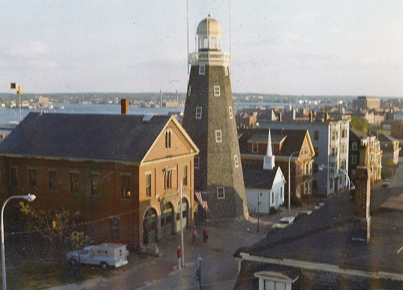 The Portland Observatory and Munjoy Hill Firehouse in 1976, the year the 1864 firehouse was razed.
