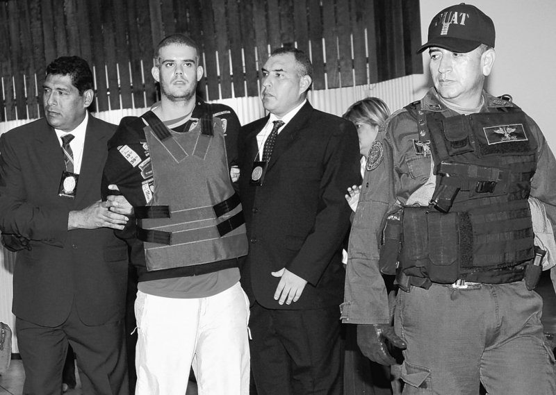 Police escort Joran Van der Sloot, second from left, during a news conference at a police station in Lima earlier this month. The young Dutchman, charged with the murder of a 21-year-old Peruvian woman, remains the lone suspect in the 2005 disappearance of U.S. teenager Natalee Holloway.