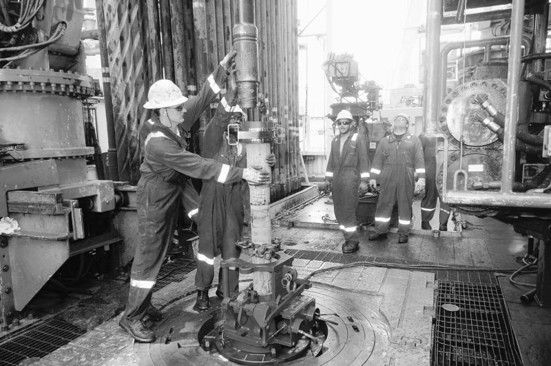 Workmen trip in the well bore Saturday aboard the Development Driller II rig as they install casing in the relief well on the drilling floor of the site of the Deepwater Horizon spill. BP's senior representative on the rig said the relief well could be completed by mid-July.