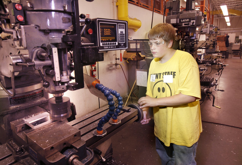 Nick Busque mills an aluminum block at Southern Maine Community College in South Portland on Wednesday as part of a week-long camp for teenagers interested in learning welding, machining and related manufacturing skills.