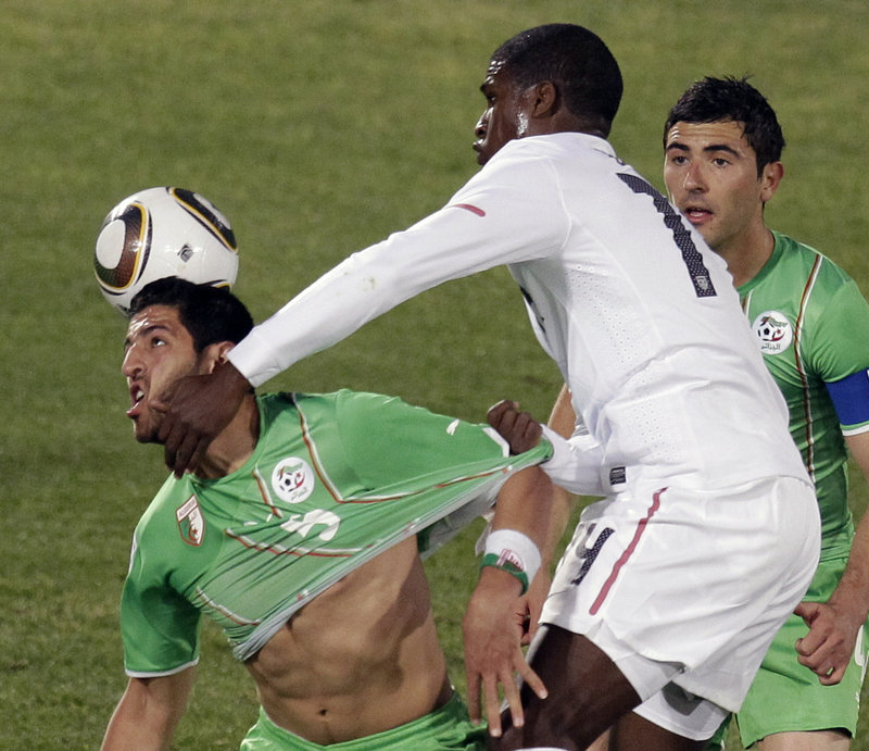 Edson Buddle, right, of the United States contends for the ball with Rafik Halliche of Algeria Wednesday during the 1-0 victory for the U.S., which will meet Ghana next.