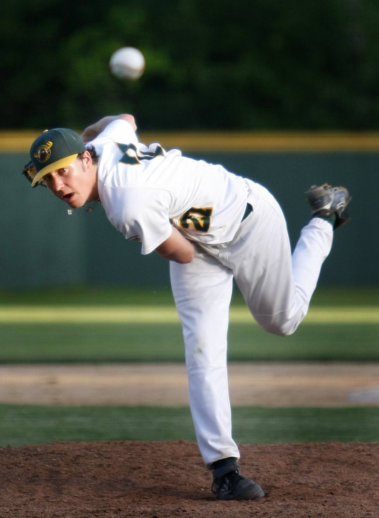 Sanford Mainers starter Kyle Helisek delivers a pitch in Wednesday night's game against the Laconia Muskrats at Goodall Park. Helisek went five innings in an 8-4 loss.