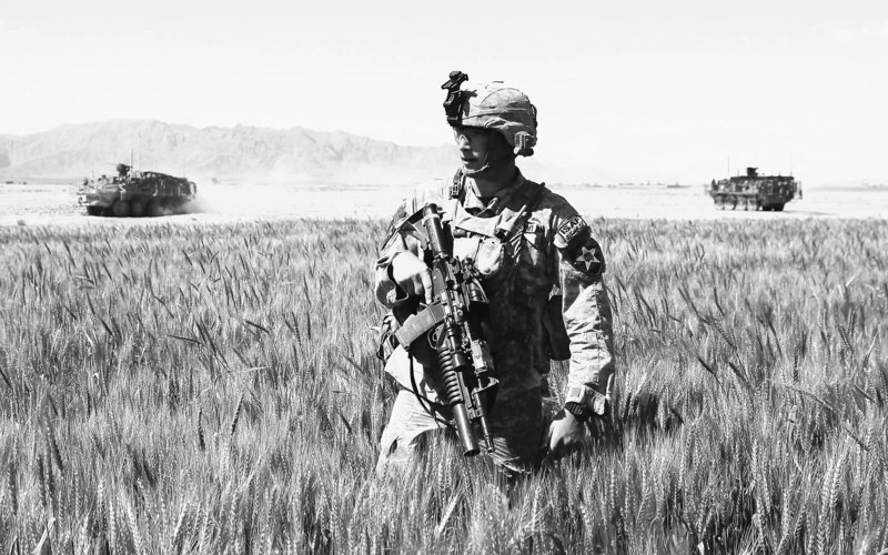 A U.S. Army soldier patrols in Kandahar province this spring. Additional troops are expected to be in Afghanistan by the end of the summer, bringing the U.S. troop level to 105,000.