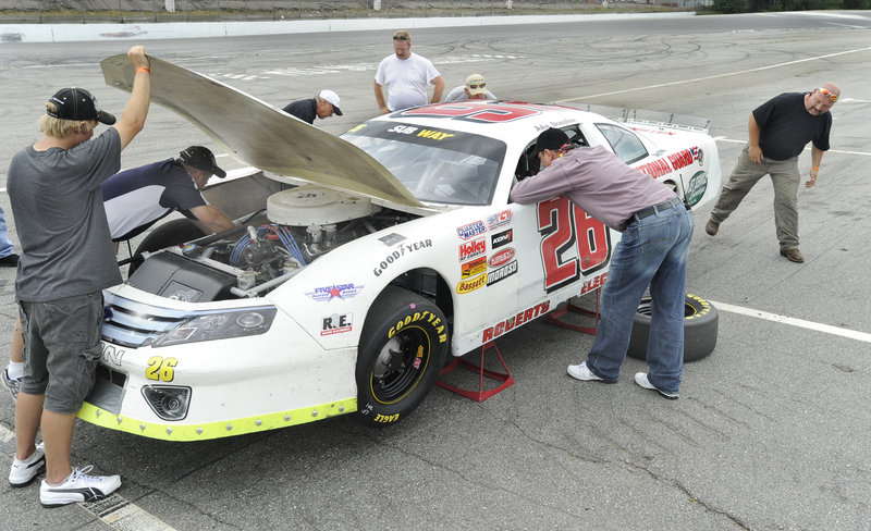Brad Keselowski waited patiently Thursday at Oxford Plains Speedway as the pit-crew members worked on the car he'll drive next month in the TD Bank 250. The crew is from the Vermont-based Roberts Racing team.