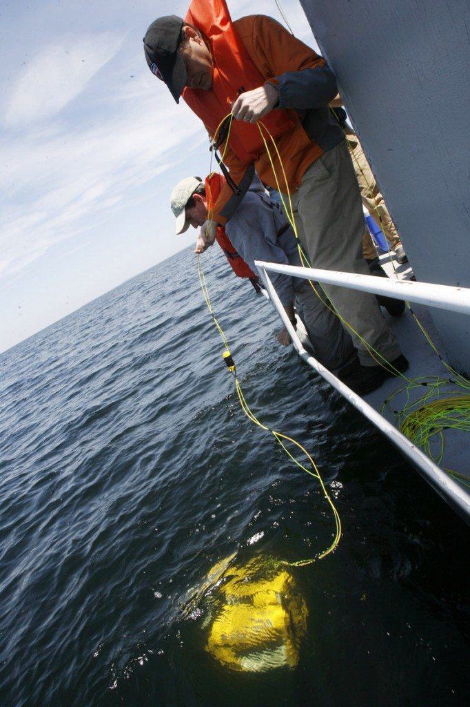 Workers launch an undersea robot camera to search for the shipwreck of a tugboat in Lake Champlain, Vt., last week. They sent the remotely operated vehicle to help determine if there is fuel aboard that could leak out.