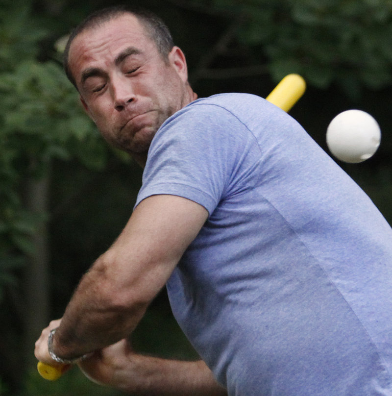 Nathan Metivier of Falmouth grimaces as he is hit with a pitch during a practice for the South Street Hard Shells Wiffle Ball team.