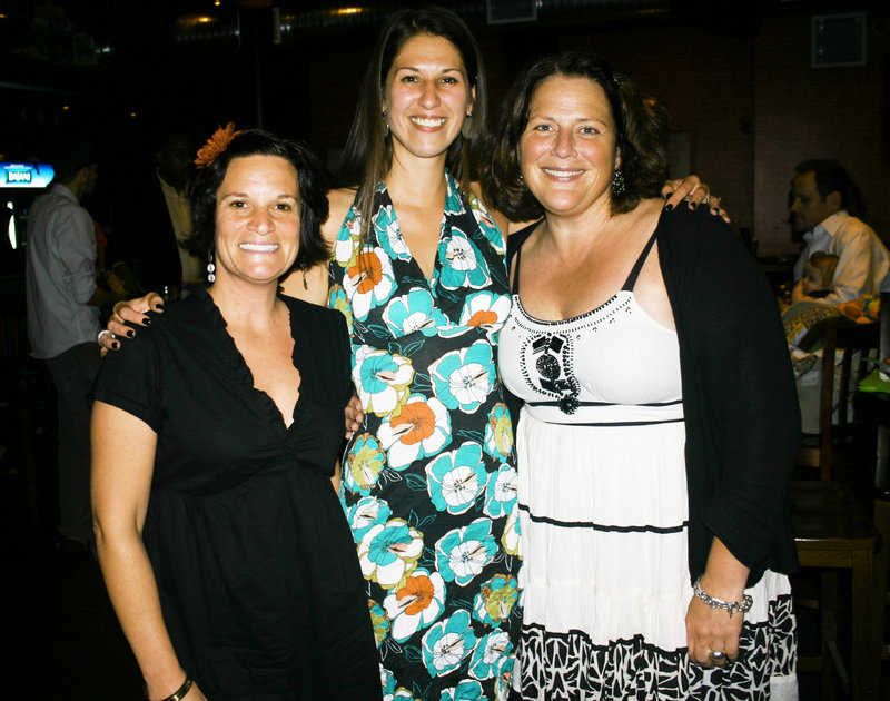 Stephanie Volo, Planet Dog's CEO, Denise Saaf, marketing manager for Planet Dog, and Kristen Smith, executive director of the Planet Dog Foundation