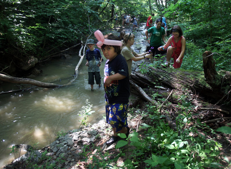 Kids at Camp Quest in Clarksville, Ohio, slog through a creek looking for animal bones and arrowheads during an archeology lesson. The sleep-away camp is for the children of atheists, agnostics, humanists and other nonbelievers.