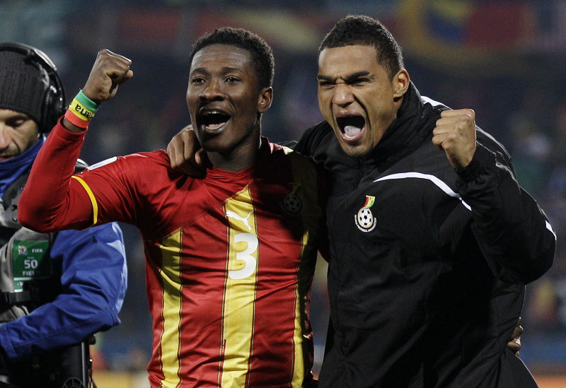 Asamoah Gyan, left, and Kevin-Prince Boateng of Ghana will be heading to a quarterfinal game against Uruguay after eliminating the United States with a 2-1 victory Saturday.