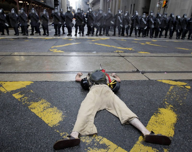 A demonstrator lies in front of a line of riot police in Toronto on Saturday as the G-20 summit got under way.