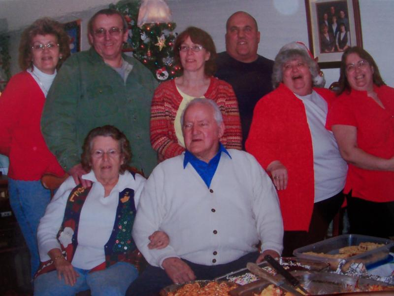 The Cousins family is shown: first row, Mrs. Dorothy Cousins and Alton; back row, Lu Ann, Donald, Gail, Lee, Sandra, Ruth.