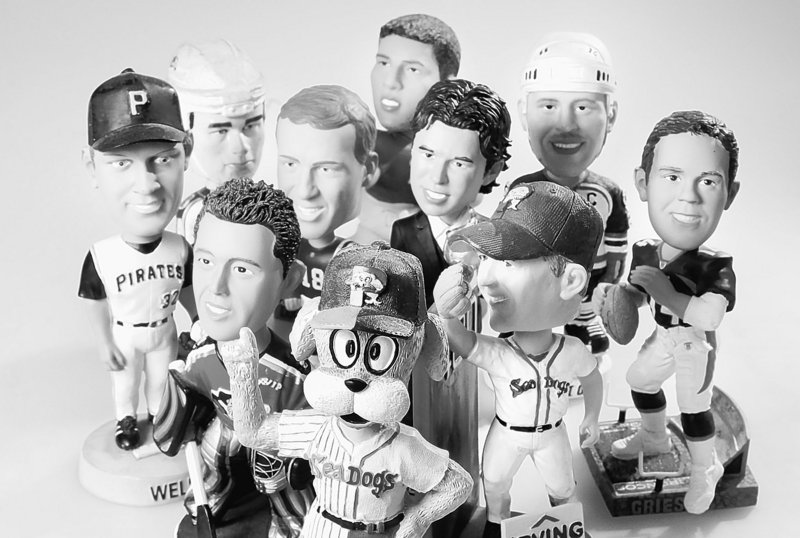 Throwaway keepsakes, like these bobblehead dolls, help tell the history of our times and should be preserved.