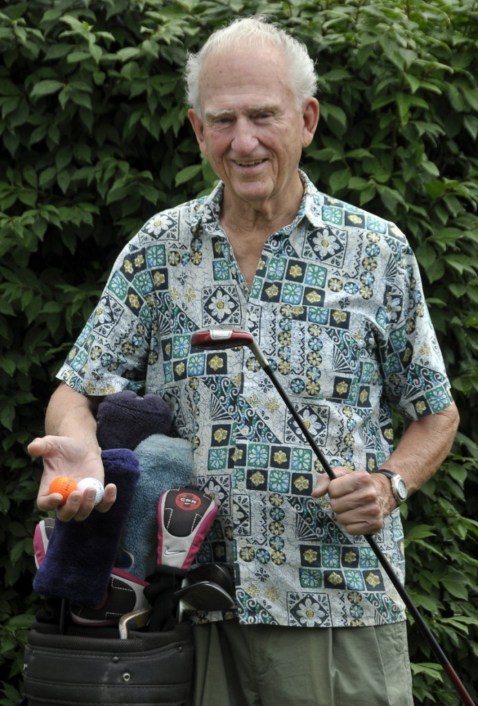 Warren Gilman of Westbrook scored the fourth hole-in-one of his playing career last week at Point Sebago in Casco. Gilman, 84, holds two of the balls he has shot for aces.