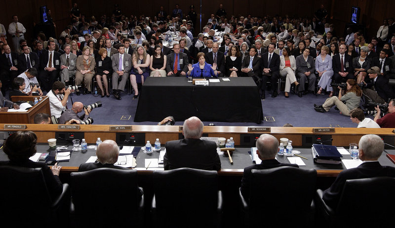 """Members of the Senate Judiciary Committee listen to Elena Kagan's opening statement. """"We don't have any substantive evidence to demonstrate your ability to transition from a legal scholar and political operative to a fair and impartial jurist,"""" Sen. Charles Grassley, R-Iowa, said in his remarks."""