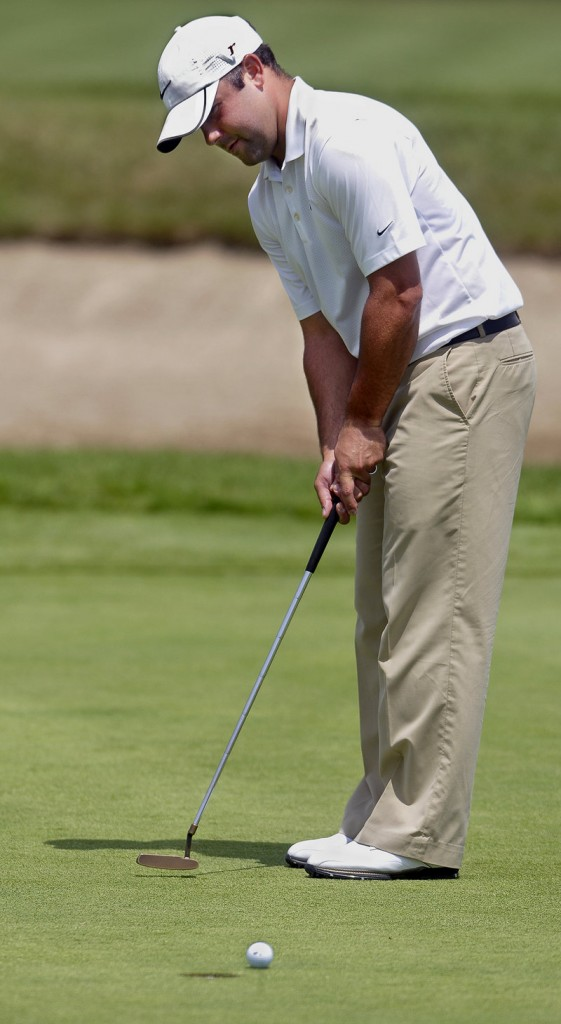 Dustin Cone of Port St. Lucie, Fla., misses a short putt for birdie, but he took advantage of enough chances to post nine birdies on his way to a 63 and the first-round lead.