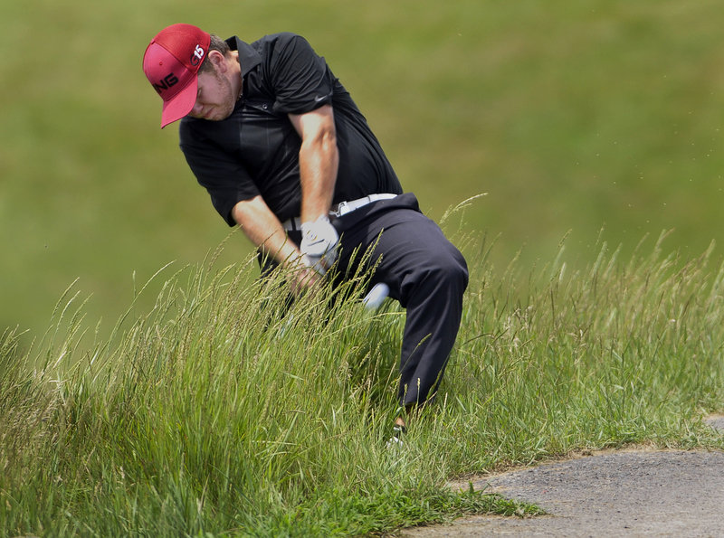 Ryan Gay, a past Maine Amateur champion from Pittston, hits out of deep rough to the 16th green Tuesday in the first round of the Charlie's Portland/Maine Open at Riverside Golf Course. Gay finished with a 73.