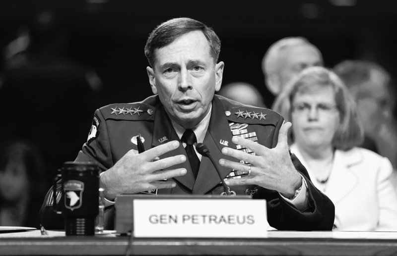 Gen. David Petraeus testifies Tuesday on Capitol Hill before the Senate Armed Services Committee. At right is his wife, Holly Petraeus.