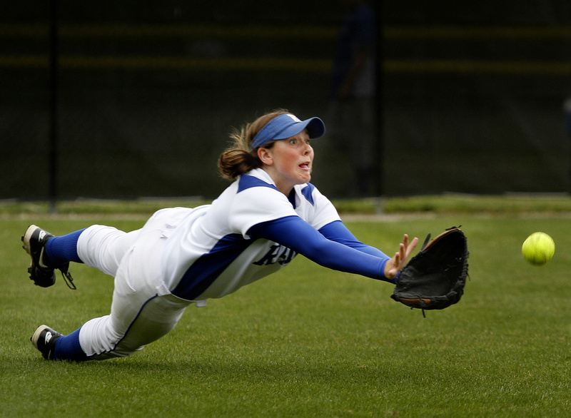 Kelsey Livermore of Kennebunk dives in a vain attempt to snag a fly ball in left field during the 7-4 loss at South Portland in a Western Class A semifinal.