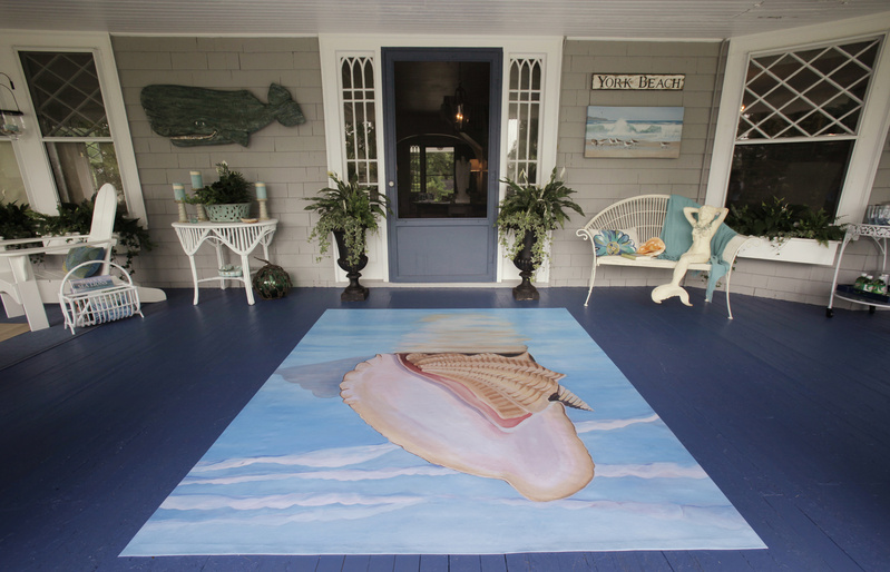 York designer Georgie McGowan painted the back porch an ocean blue and used an oilcloth with a seascape on it as a floor covering. Oilcloths were used in the early 1900s on porches or verandas.