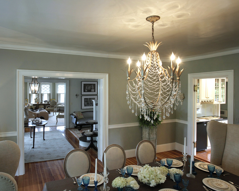 A chandelier provides a focal point in a dining room designed by Nicole Yee at Twin Cottage.