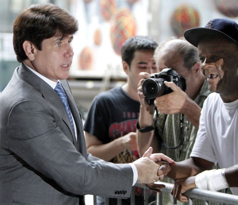 Former Illinois Gov. Rod Blagojevich shakes hands with supporters as he arrives at the Federal Court today in Chicago. Blagojevich and his brother are accused of scheming to sell or trade President Obama's old Senate seat.