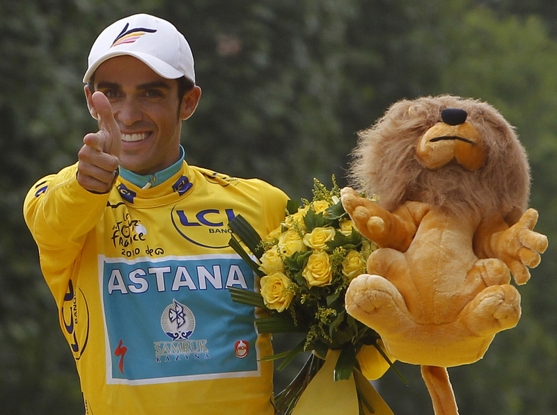 Three-time Tour de France winner Alberto Contador of Spain celebrates on the podium after the 20th and last stage of the Tour de France cycling race today in Paris.