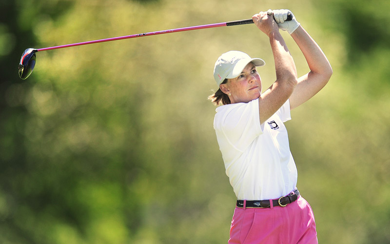 Leslie Guenthner watches a tee shot on the second day of the three-day tournament.