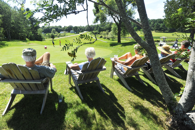On a perfect day for a little bit of shade, a bit of refreshments and a lot of watching golf, fans sat by the green on the 18th hole Tuesday at the Bath Country Club and followed the golfers in the women's state championship.