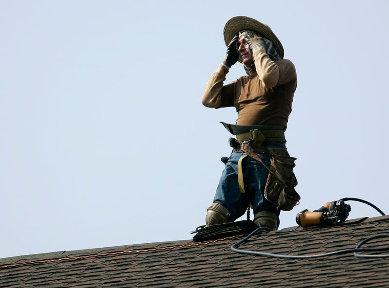 A construction worker wipes sweat from his face as he works on a solar panel installation project at Park Ridge High School in Park Ridge, N.J., today. Temperatures in the Northeast are expected to reach 100 for the second straight day.