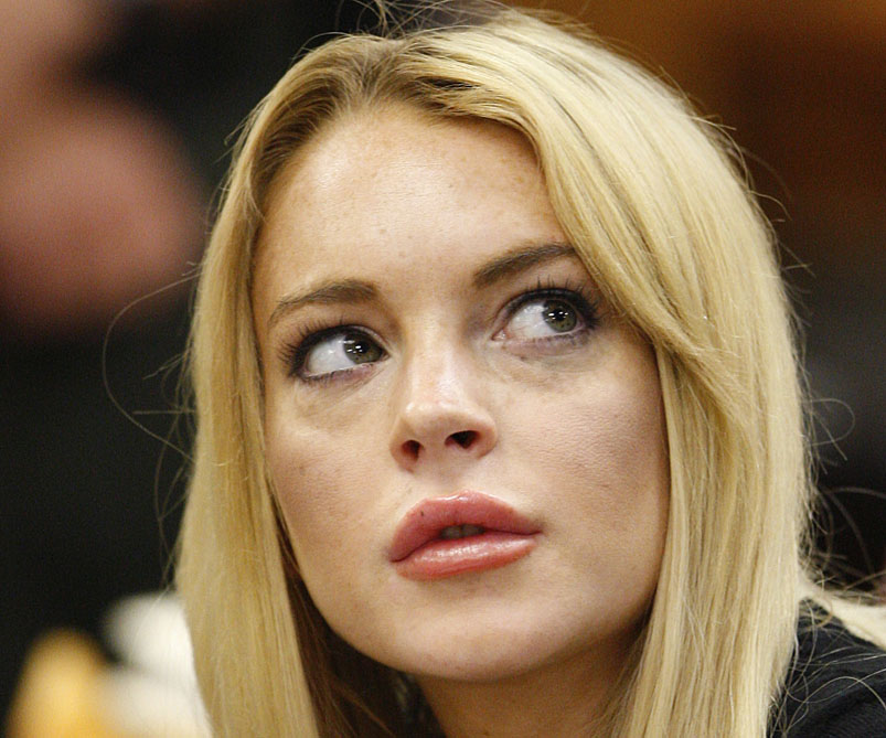 In this July 6 photo, actress Lindsay Lohan appears in a courtroom for a probation revocation hearing in Beverly Hills, Calif. Lohan is scheduled to turn herself in today to begin serving a 90-day jail sentence.