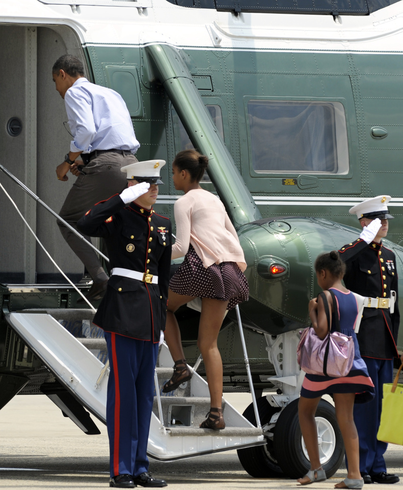 President Barack Obama, followed by his daughters Malia, center, and Sasha, right, board Marine One at Andrews Air Force Base today on their return to the White House after a weekend vacation Maine.