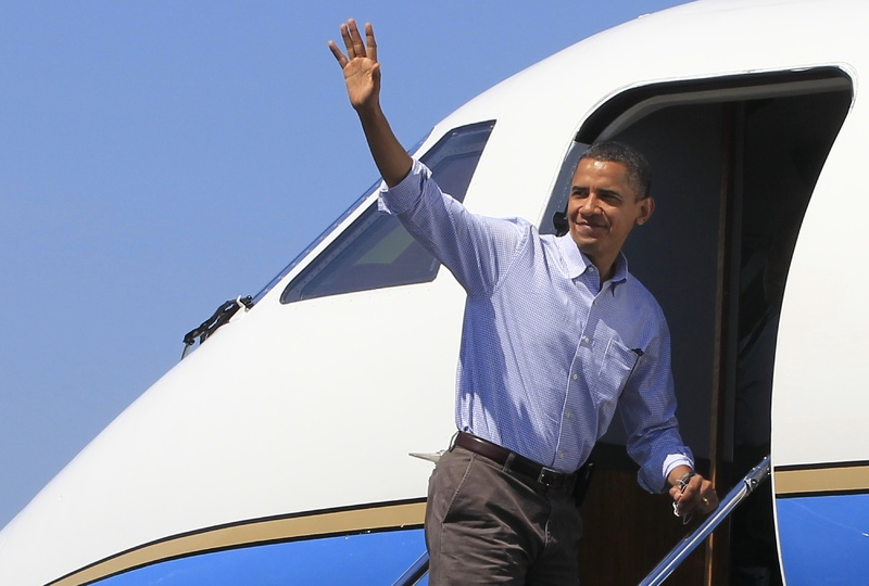 President Obama boards Air Force One at Hancock County-Bar Harbor Airport in Trenton on Sunday for the trip back to Washington.