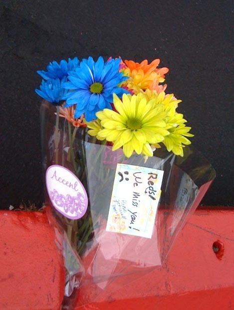 A bouquet was left in the parking lot by a fan who misses Red's Dairy Freeze in South Portland.