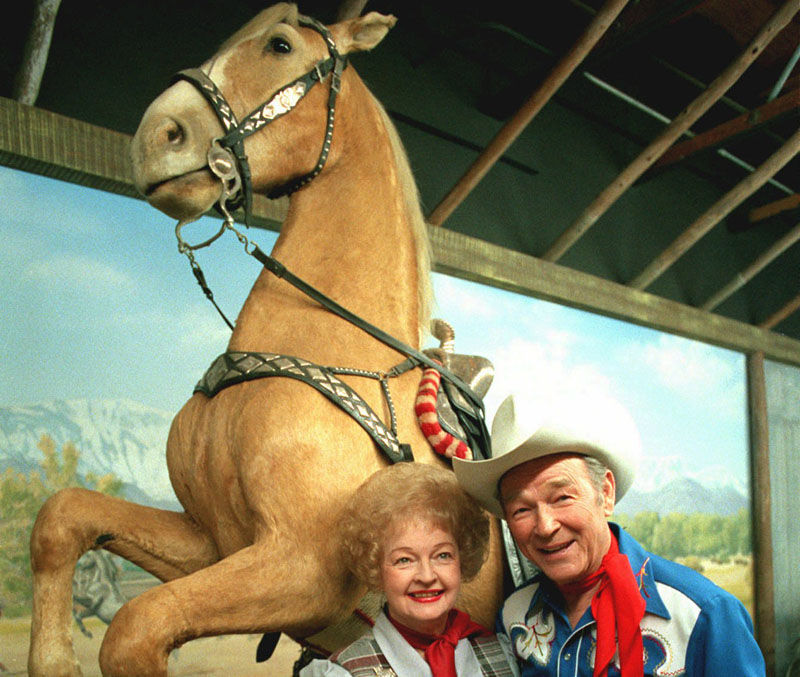 In this Feb. 15, 1984 file photo, Roy Rogers is shown with his wife Dale Evans before the stuffed remains of Trigger, Roy's horse, at the Roy Rogers museum in Victorville, Calif. An upcoming New York auction will feature Rogers belongings including the preserved remains of his famous horse, Trigger. The presale estimate for the dead horse is $100,000 to $200,000.