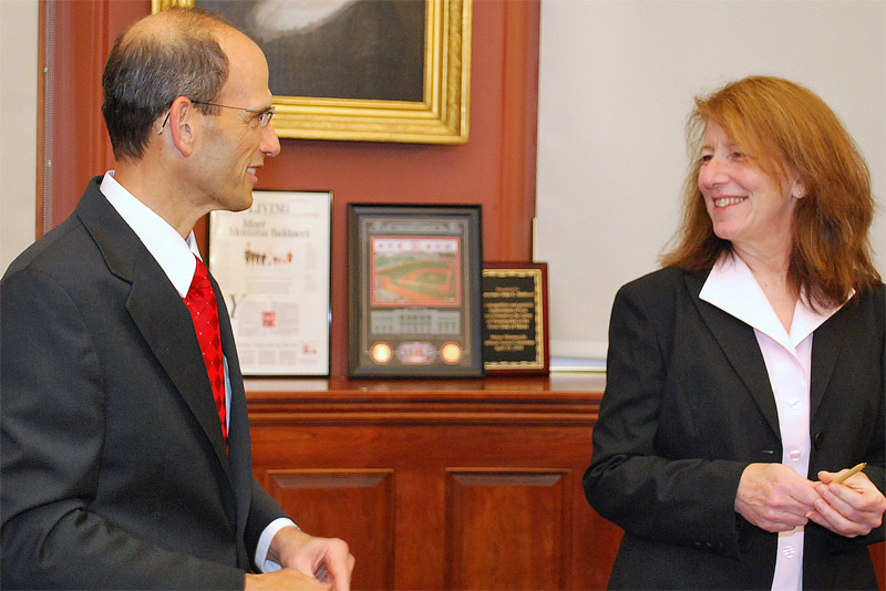 Gov. John Baldacci talks with Ellen Schneiter, new acting commissioner of the Department of Administrative and Financial Services.