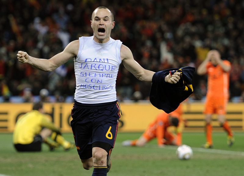 Spain's Andres Iniesta celebrates after scoring a goal, with the words